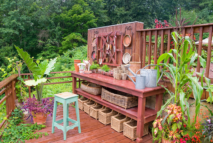 Pretty garden chore area potting bench Plant Flower Stock