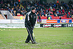 Brechin v St Johnstone....12.03.11  Scottish Cup Quarter Final.Brechin boss Jim Weir forking the waterlogged Glebe Park pitch.Picture by Graeme Hart..Copyright Perthshire Picture Agency.Tel: 01738 623350  Mobile: 07990 594431