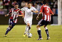 DC United forward Jaime Moreno attempts to move past Chivas USA players Dario Delgado (l) and Marcelo Saragosa (r). CD Chivas USA beat DC United 1-0 at Home Depot Center stadium in Carson, California on Sunday August 29, 2010.