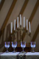 Wine glasses sit empty on the altar before a Mass at a Catholic church in Columbus, Ohio<br />