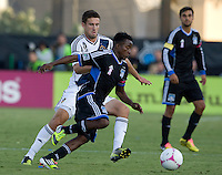 Marvin Chavez of Earthquakes dribbles the ball away from Tommy Meyer of Galaxy during the game at Buck Shaw Stadium in Santa Clara, California on October 21st, 2012.  San Jose Earthquakes and Los Angeles Galaxy tied at 2-2.