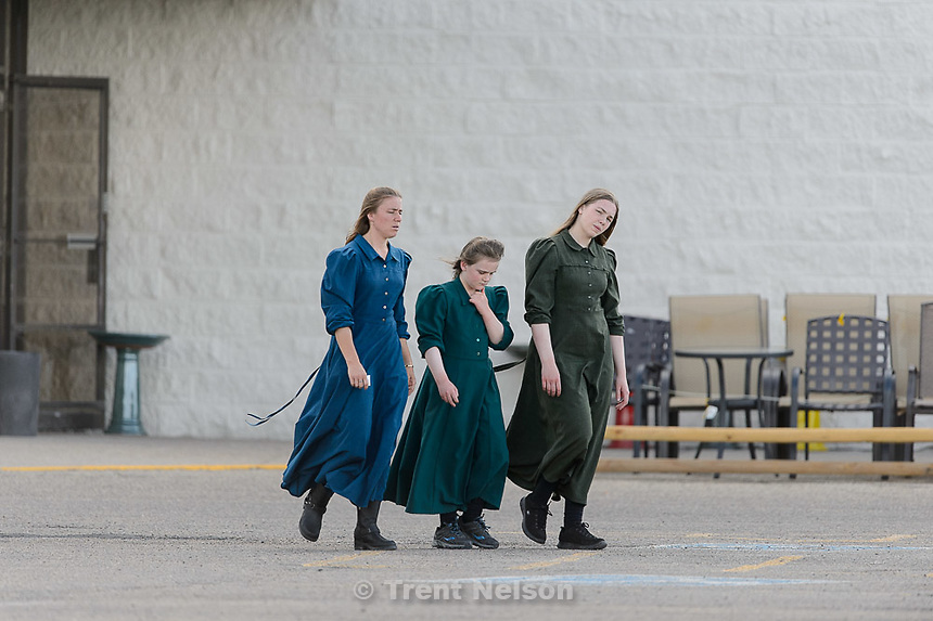Trent Nelson  |  The Salt Lake Tribune<br /> Three young women in fundamentalist prairie dresses in the parking lot of a retail store in Rawlins, Wyoming, Tuesday June 30, 2015.