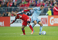 Sporting KC midfielder Davy Arnaud #22 and Toronto FC defender Mikael Yourassowsky #19 in action during an MLS game between Sporting Kansas City and the Toronto FC at BMO Field in Toronto on June 4, 2011..The game ended in a 0-0 draw...