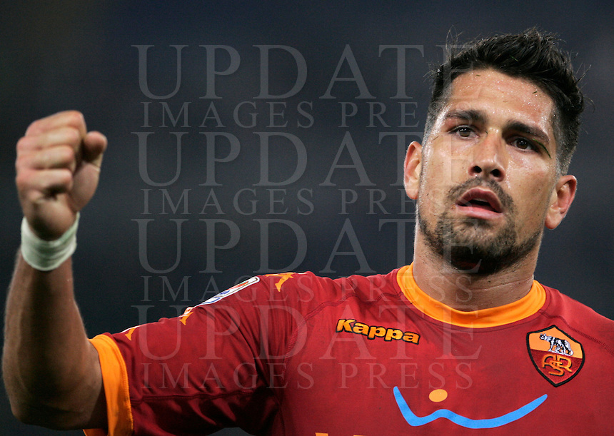 Calcio, Serie A: Roma-Genoa. Roma, stadio Olimpico, 15 ottobre 2010..Football, Italian serie A: AS Roma vs Genoa. Rome, Olympic stadium, 15 october 2010..AS Roma forward Marco Borriello cheers fans at the end of the match. AS Roma won 2-1..UPDATE IMAGES PRESS/Riccardo De Luca