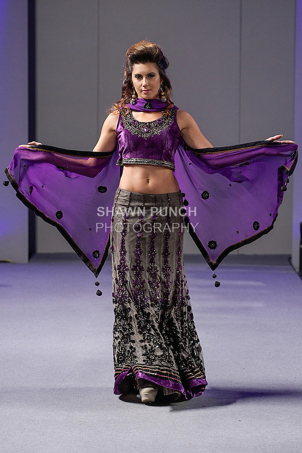 Model walks runway in an outfit from the Pure Elegance collection by Parna Ghose during Couture Fashion Week Spring 2013 in NYC, on September 16, 2013.