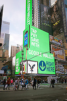 The giant illuminated video display on the exterior of the American Eagle Apparel store in Times Square in New York promotes the use of Google Wallet for purchases, seen on Wednesday, February 15, 2012. Google recently announced two security flaws in their payment system one of which has caused them to suspend customers' ability to refill prepaid cards. (© Richard B. Levine)