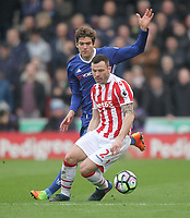 Stoke City's Phillip Bardsley battles with Chelsea's Marcos Alonso<br /> <br /> Photographer Mick Walker/CameraSport<br /> <br /> The Premier League - Stoke City v Chelsea - Saturday 18th March 2017 - bet365 Stadium - Stoke<br /> <br /> World Copyright &copy; 2017 CameraSport. All rights reserved. 43 Linden Ave. Countesthorpe. Leicester. England. LE8 5PG - Tel: +44 (0) 116 277 4147 - admin@camerasport.com - www.camerasport.com
