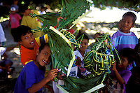 Young native boys in Yap display ti leaf handicrafts, in Yap, Micronesia.