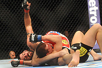 "April 21, 2012 - Atlanta, Georgia: The strongest fighters in UFC went head to head in Philips Arena. One of the most violent fights of the night featured welterweights Stephen ""Wonder Boy"" Thompson (black shorts) vs. Matt Brown (red shorts). Towards the end of the fight Brown held ""Wonder Boy"" down and repeatedly punched him in his bloody face. The crowd cheered madly."