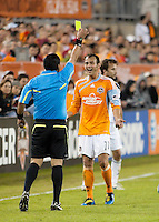 Brad Davis of the Houston Dynamo receives a yellow card caution from referee Baldomero Toledo during the regular season game between the Los Angeles Galaxy and the Houston Dynamo at Robertson Stadium in Houston, TX on April 10, 2010. Los Angeles 2, Houston 0.