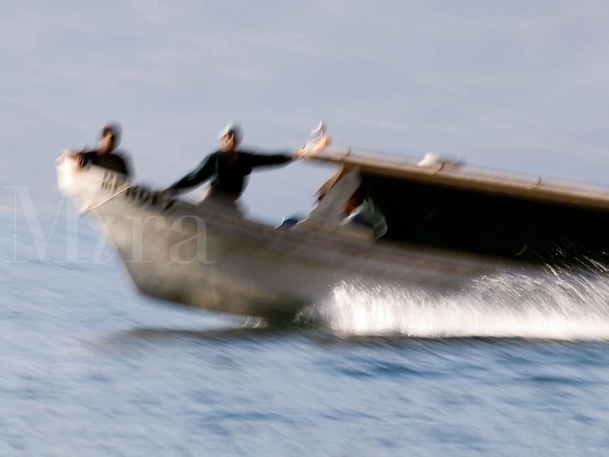 "Local transportation boat known as ""launcheros"" on Lake Atitlan near Santiago Atitlan, Guatemala."