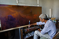 Jean Pierre Theard, artist painting post earthquake subjects in his home studio.