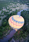 Africa, Kenya, Masai Mara. Tourists ballooning over the Talek river.
