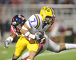 LSU cornerback Tyrann Mathieu (7) is hit by Ole Miss' Vincent Moss (23) at Vaught-Hemingway Stadium in Oxford, Miss. on Saturday, November 19, 2011..