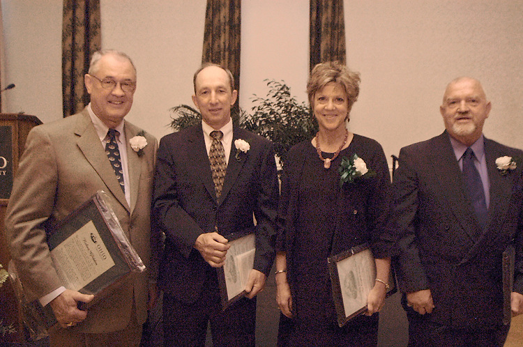 164822004 Outstanding Admisistrator Award, Ann Brown, Norman Lowery..Ohio University Outstanding Administrator Award winners; (l to r) Dr. Robert Glidden, received an honorary award after serving the university for 10 years, Harold Nihiser; OU Lancaster's physical plant director; Ann Cammpbell Brown, director of The Nationally Competitive Awards; and Norman Lowery, Interim Director, Residence Custodial Services and Assistant Director.