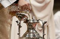 Un diacono versa olio santo in un'anfora durante la Santa Messa del Crisma celebrata dal Papa nella Basilica di San Pietro, Citta' del Vaticano, 13 aprile 2015.<br /> A deacon pours holy oil inside an amphora during a Chrism Mass celebrated by the Pope in St. Peter's Basilica at the Vatican,at the Vatican, on April 13, 2017.<br /> UPDATE IMAGES PRESS/Isabella Bonotto<br /> STRICTLY ONLY FOR EDITORIAL USE