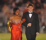 Senior maid Micaela Woods is escorted by Zach Cain at Lafayette High vs. Lewisburg in Homecoming football action in Oxford, Miss. on Friday, September 30, 2011.