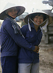 Two women construction workers in Hanoi, North Vietnam.  (Jim Bryant Photo).....