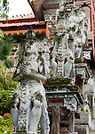 Stone guardians line the central staircase, ascending from the lower central square to the upper temple levels at the Bramavihara-Arama Buddhist Temple, in northern Bali (Indonesia).