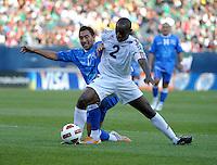 Cuba's Carlos Domingo Francisco battles for the ball with El Salvador's Arturo Alvarez.  El Salvador defeated Cuba 6-1 at the 2011 CONCACAF Gold Cup at Soldier Field in Chicago, IL on June 12, 2011.