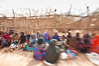 Women waiting in line for a special distribution of clothes and food at a refugee run mosque in Dadaab refugee camp. The camp has become home to waves of refugees from Somalia over the past 20 years. The old arrivals often pool resources to help new arrivals settle.