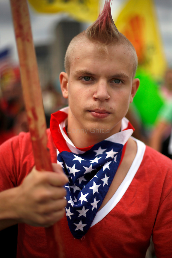 A protester at a student rally. Thousands of activists protested the 2008 Republican National Convention in St. Paul, MN from September 1-4. While some marches were peaceful, others led to violence by both the protesters and riot police.