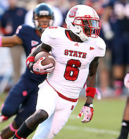 Oct. 22, 2011 - Charlottesville, Virginia - USA; North Carolina State wide receiver T.J. Graham (6) runs the ball during an NCAA football game against the Virginia Cavaliers at the Scott Stadium. NC State defeated Virginia 28-14. (Credit Image: © Andrew Shurtleff/
