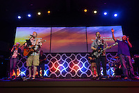 NWA Democrat-Gazette/BEN GOFF @NWABENGOFF<br /> The worship team leads the congregation in song on Saturday June 4, 2016 during a ribbon-cutting and 'big reveal' for the newly renovated auditorium at New Life Christian Church in Bella Vista. The church was opened in 1974 as Bella Vista Christian Church and has undergone several expansions over the years. The church rebranded itself New Life Christian at the beginning of the year and began the renovation project for the auditorium on March 28.