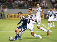 CARSON, CA - September 1, 2012: Vancouver midfielder Russell Teibert (31) and LA Galaxy defenders Sean Franklin (5) and Omar Gonzalez (4) during the LA Galaxy vs the Vancouver Whitecaps FC at the Home Depot Center in Carson, California. Final score LA Galaxy 2, Vancouver Whitecaps FC 0.