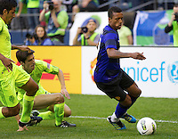 Manchester United forward Nani changes direction in front of Seattle Sounders FC midfielder Alvaro Fernandez, center and defender Leonardo Gonzalez during play at CenturyLink Field in Seattle Wednesday July 20, 2011. Manchester United won the match 7-0.