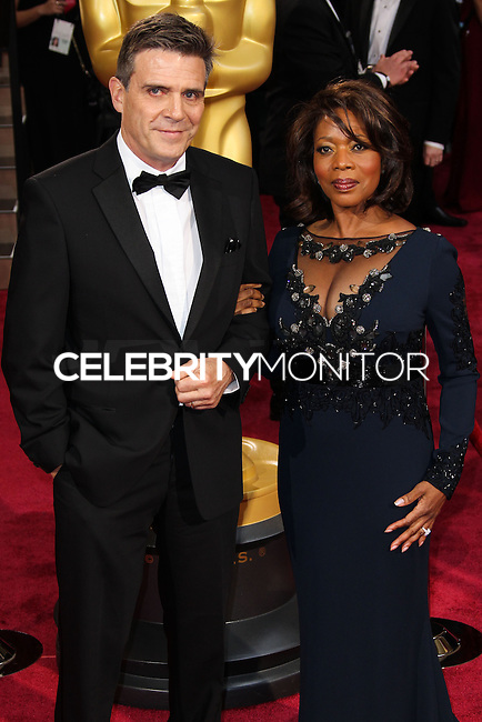HOLLYWOOD, CA, USA - MARCH 02: Roderick Spencer, Alfre Woodard at the 86th Annual Academy Awards held at Dolby Theatre on March 2, 2014 in Hollywood, Los Angeles, California, United States. (Photo by Xavier Collin/Celebrity Monitor)