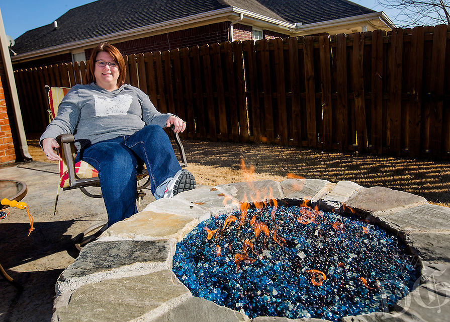 NWA Democrat-Gazette/JASON IVESTER<br /> Joyce Grippi; photographed on Thursday, Feb. 11, 2016, in her favorite place: next to the firepit on the patio of their Bentonville home