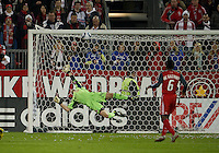 13 April 2011: Toronto FC goalkeeper Stefan Frei #24 dives for a shot from Los Angeles Galaxy forward Chad Barrett #11during an MLS game between Los Angeles Galaxy and the Toronto FC at BMO Field in Toronto, Ontario Canada..The game ended in a 0-0 draw.