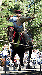 An exponent of yabusame horseback archery draws his bow during the annual Reitaisai Grand Festival at Tsurugaoka Hachimangu Shrine in Kamakura, Japan on  14 Sept. 2012.  Sept 14 marks the first day of the 3-day Reitaisai festival, which starts early in the morning when shrine priests and officials perform a purification ritual in the ocean during a rite known as hamaorisai and limaxes with a display of yabusame horseback archery. Photographer: Robert Gilhooly