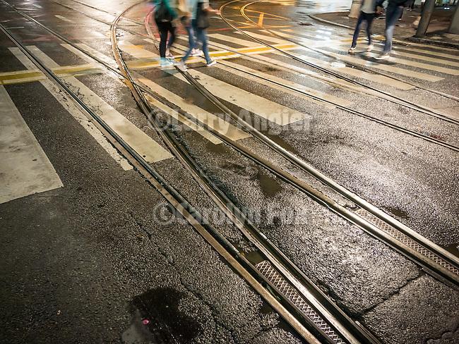 Painted crosswalk bars and rails, trolley tracks, and crosswalk along Alexander Boulevard, Streets at night in Belgrade, Serbia