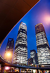 Circular pedestrian overpass and skyscrapers in Lujiazui, Pudong, Shanghai, China. Nighttime scenery. 2014