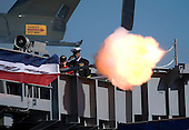 Norfolk, VA - January 10, 2009 -- Sailors fire the saluting battery in honor of President George W. Bush at the commissioning ceremony for the aircraft carrier USS George H.W. Bush (CVN 77) at Naval Station Norfolk, Va. The Navy's newest, and final, Nimitz-class aircraft carrier is named after World War II naval aviator and the 41st president of the United States George H.W. Bush. .Credit: Chad J. McNeeley - U.S. Navy via CNP