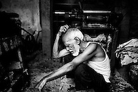 Mohammad Habib, 90, takes rest after leather processing in a factory of the Hazaribagh tannery area, Dhaka, Bangladesh. Habib has been working in Hazaribagh tanneries for 55 years, seeing the change in the area over the decades, especially the increase in pollution with hundreds of factories operating without any safety measures. Despite his age, Habib has no option but to work in order to survive, after his two wives died of cancer and his children got married and moved away.