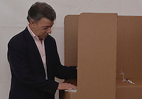 BOGOTA, Colombia. 15th June 2014. The President of Colombia Juan Manuel Santos marks his vote during the runoff for presidential election in Bogota. Photo by Campaign/Cesar Carrión / VIEWpress TO EDITORS : THIS PICTURE WAS PROVIDED BY A THIRD PARTY.  THIS PICTURE IS DISTRIBUTED EXACTLY AS RECEIVED BY VIEWpress, AS A SERVICE TO CLIENTS