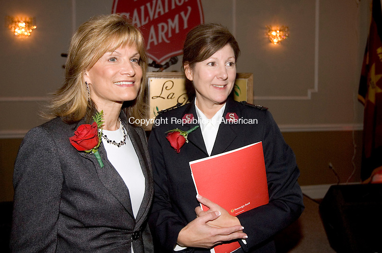 WATERBURY CT. 30 October 2013-103013SV04-From left, Cathy Dalton, Membership Director of the Greater Waterbury Chamber of Commerce, and Major Annette Lock of the Salvation Army talk during the Salvation Army's Kettle Kick-Off Breakfast a the Ponte Club in Waterbury Wednesday. Dalton was honored with Doing the Most Good Award.<br /> Steven Valenti Republican-American