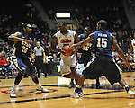 "Ole Miss' Murphy Holloway (31) shoots against East Tennessee State's Hunter Harris (20), East Tennessee State's Kinard Gadsden-Gilliard (35), and East Tennessee State's Lester Wilson (15) at the C.M. ""Tad"" Smith Coliseum in Oxford, Miss. on Saturday, December 14, 2012. Mississippi won 77-55 to improve to 7-1. (AP Photo/Oxford Eagle, Bruce Newman).."