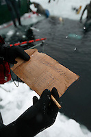 A judge makes notes during freediving competition Oslo Ice Challenge, held at freshwater lake Lutvann outside the Norwegian capital Oslo. Atheletes, including current and former world champions, entered a hole in the ice to compete. The participants reached depths down to 52 meters below the surface.