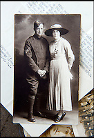 BNPS.co.uk (01202 558833)<br /> Pic: C&amp;TAuctions/BNPS<br /> <br /> Norman's father CPl Albert Mayo who served in the Royal Flying Corps pictured with his wife Annie.<br /> <br /> A poignant time capsule containing the last belongings of a tragic airman his grief-stricken parents couldn't bring themselves to look at has been discovered during a house clearance.<br /> <br /> The poignant archive of letters, logbooks, diary, photos and medals relating to Flight Sergeant Norman Mayo were placed in a small suitcase in 1945 by Albert and Annie Mayo and seemingly never opened again.<br /> <br /> The black leather case was found stashed under a bed by a house clearance firm tasked with getting rid of the contents before the empty property in Finchley, North London.<br /> <br /> The archive is now being sold by C&amp;T Auctioneers.
