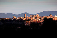 View of the historic village of Orvieto and the Duomo at sunset from Palazzone Vineyards, Umbria, Italy