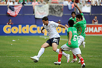 Santino Quaranta (20) of the United States (USA) is marked by Israel Castro (8) and Fausto Pinto (5) of Mexico (MEX). Mexico (MEX) defeated the United States (USA) 5-0 during the finals of the CONCACAF Gold Cup at Giants Stadium in East Rutherford, NJ, on July 26, 2009.