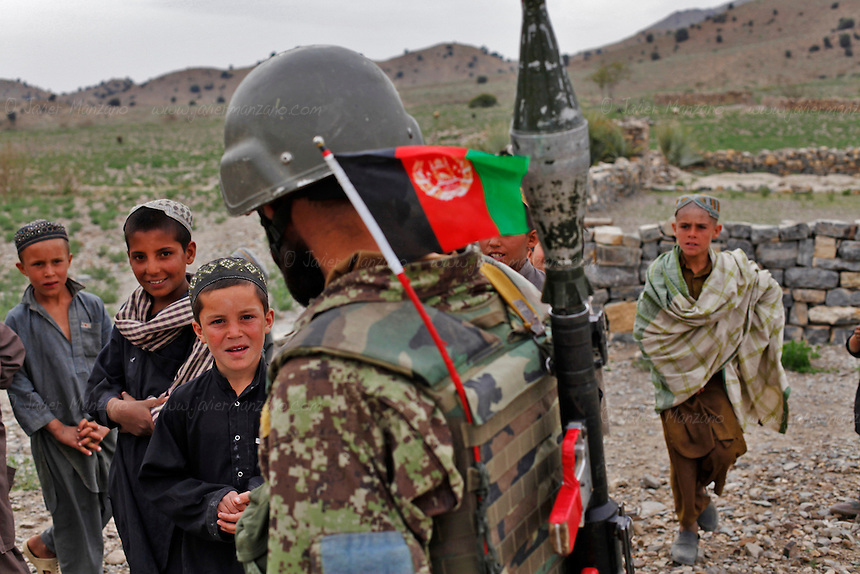 Members of the Afghan National Army lead a weapons search at a village close to the border with Pakistan as part of a 4-day joint mission with 2nd Platoon, Comanche Company, 1-501 IN (ABN) (Task Force Blue Geronimo) out of Fort Richardson Alaska...International forces are increasingly relying on Afghan National Security Forces (ANSF) such as the Afghan National Army  (ANA) in conducting village searches, key village leader engagements and biometrics intelligence gathering operations in preparation for the 2013 handover of security operations to the ANSF. Although no weapons were found on this day, the means by which the ANA conducted their search was superficial at best and involved no metal detectors.