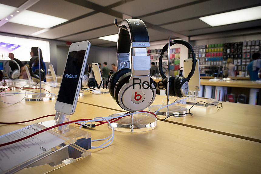 Headphones by Beats Electronics are seen in an Apple store in New York on Saturday, May 10, 2014. Apple announced that it will be buying Beats Electronics, the maker of the popular hip Beats by Dr. Dre audio equipment, for $3.2 billion. .  (© Richard B. Levine)