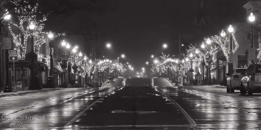 Looking along Lakeshore in downtown Oakville at the Christmas street lights in black & white