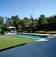 A view from the shady paved terrace, at the back of the house, towards the swimming pool