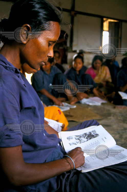 Woman reads during an adult literacy class.
